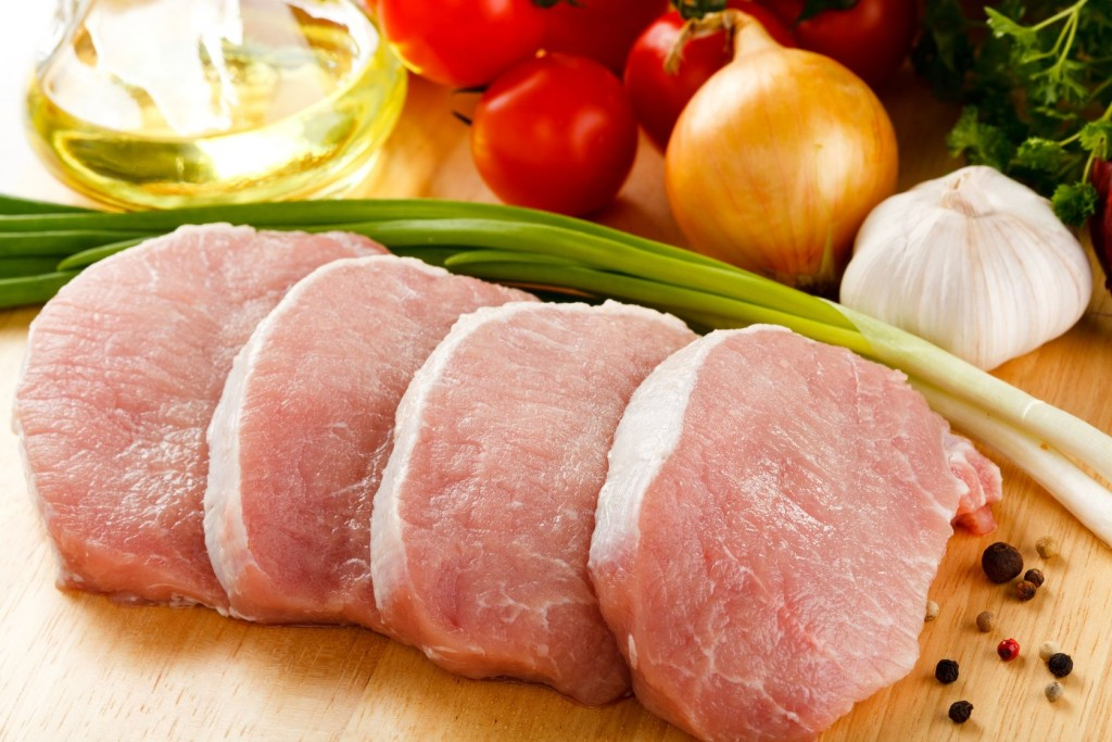 18406372 - raw pork on cutting board and vegetables